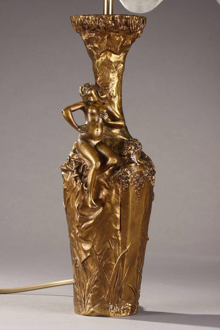 Gilt bronze sculptural vase by Jules Meliodon (French, 1867-after 1940), decorated with woman and satyr on a naturalistic background. Mounted as lamp and electrified. Signed Jules Méliodon and dated 1896. Marked Louchet underneath the base. Art