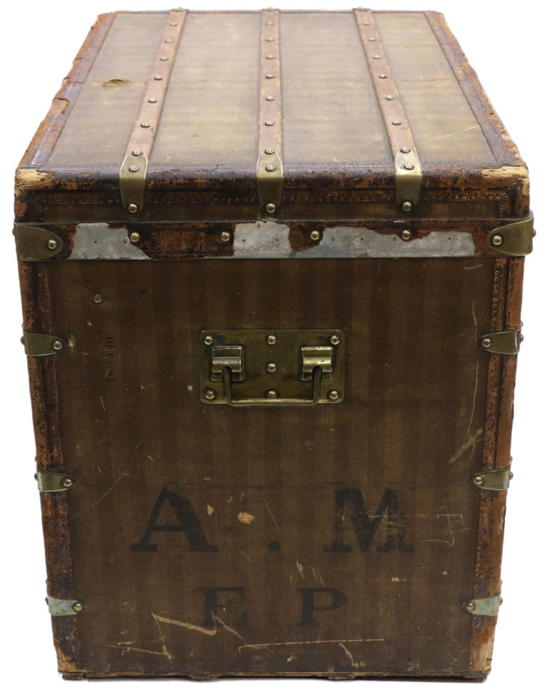 Late 19th century Louis Vuitton striped canvas steamer trunk with multiple storage compartments. Not only is this late 19th century Louis Vuitton steamer trunk a functional piece of storage, it is also the perfect decorative accessory whether it's