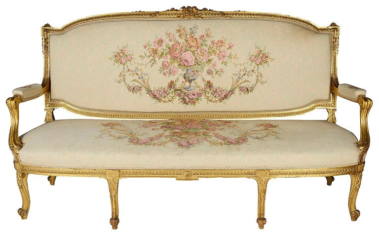 A good quality late 19th century carved giltwood Louis XVI style three-seat sofa, having scrolling motif and foliate decoration, tapestry upholstery and raised on elegant cabriole legs.