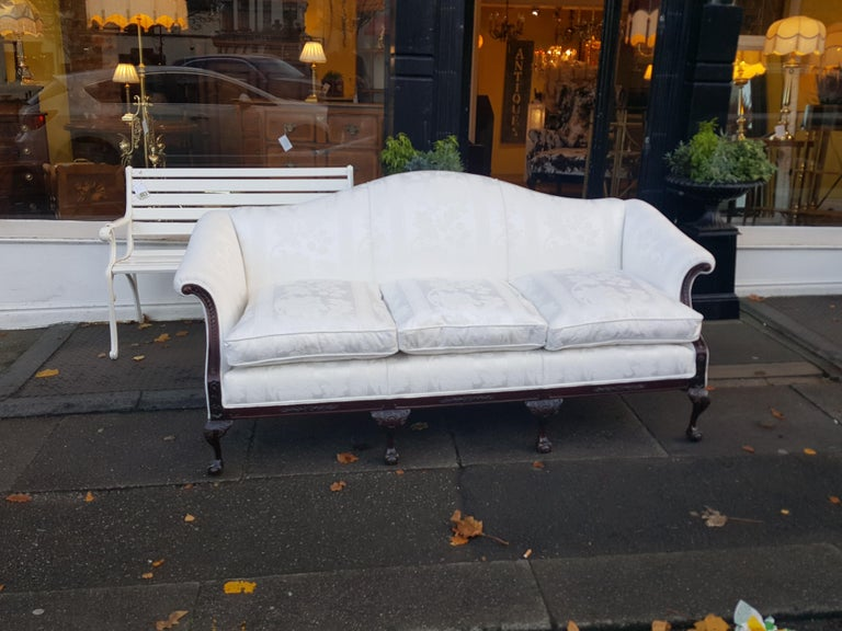 Late 19th century mahogany camel back sofa with 4 Chippendale style ball and claw feet. Measures: 81
