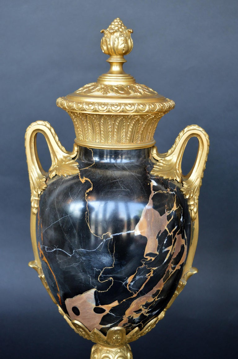 Gold and black marble set in bronze. Italian.