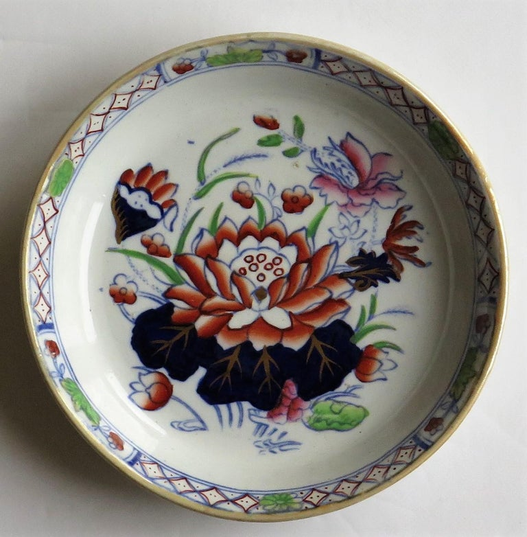This is a smalldish or pin tray in the very decorative water lily pattern, produced by the Mason's factory at Lane Delph, Staffordshire, England, circa 1897.  The dish is well decorated in one of Mason's most beautiful chinoiserie patterns,