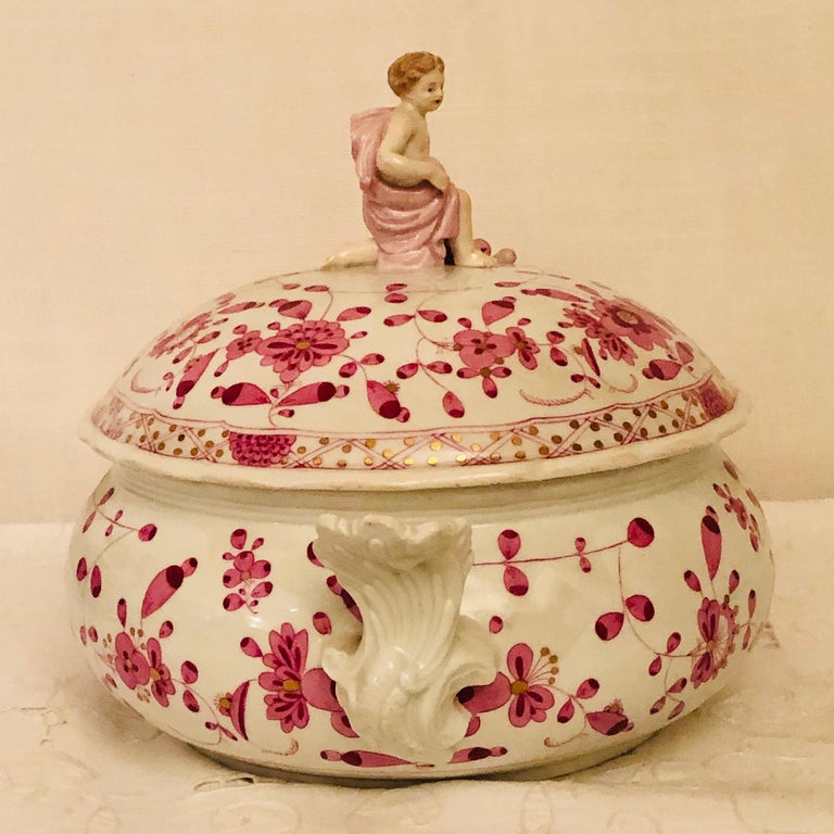 How charming is this late 19th century Meissen purple Indian round tureen with a figure holding a cornacopia with fruit on the cover. This is such a bright cheerful piece of Meissen. It is so delightful when the Meissen company decorated their