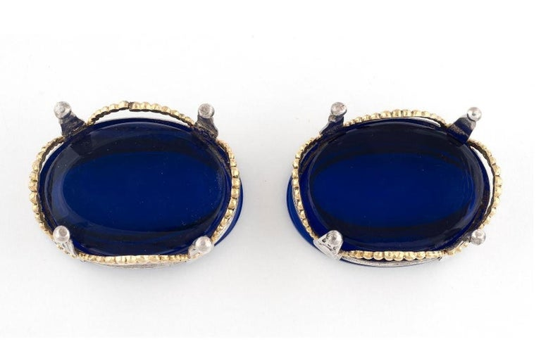 Oval form in silver and silver gilt, on four feet, with blue glass liners,length 7.6cm Weight : 124.6gr.