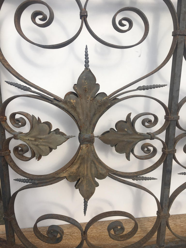 Late 19th century hand crafted iron grilles or balcony railing from the Monte Carlo estate of Aristotle Onassis. This ornate balcony railing features beautiful feuilles acanthe motifs on both sides elegant swirls and curves.  There are no apparent