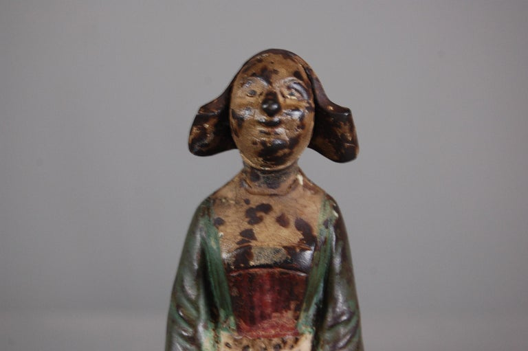 Charming late 19th century cast iron money box, original painted surface, losses to feet, mounted to a later stand. Marked