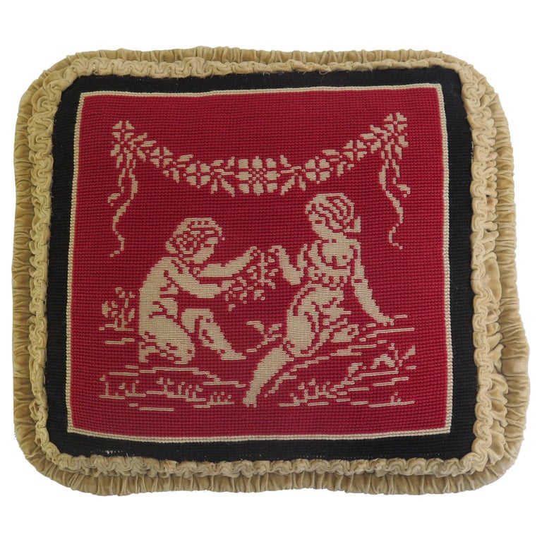 This is a very attractive and unusual needlepoint tapestry pillow or cushion with a classical design, which we date to the late 19th century. 