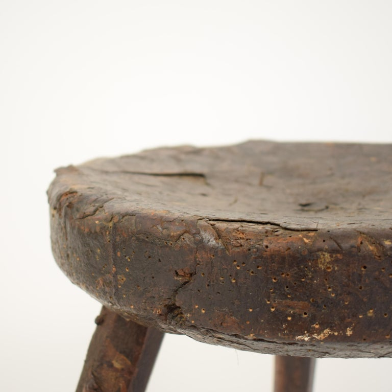 This Primitive Elm country splayed leg wood stool was made in the late 19th century, circa 1880.