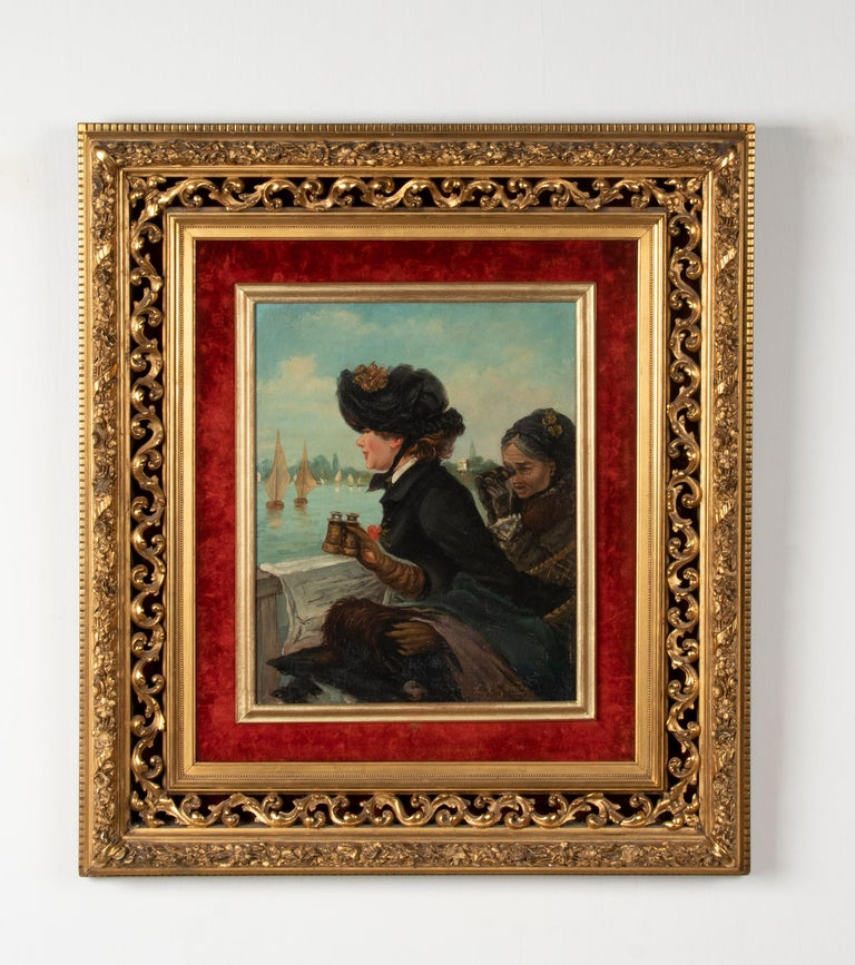 A romantic painting depicting two women sitting on the shore of a lake, looking at the sailboats. It is painted with oil on canvas. The painting is signed with E.L. Garrido. However, this painting was not painted by this Spanish master. But the