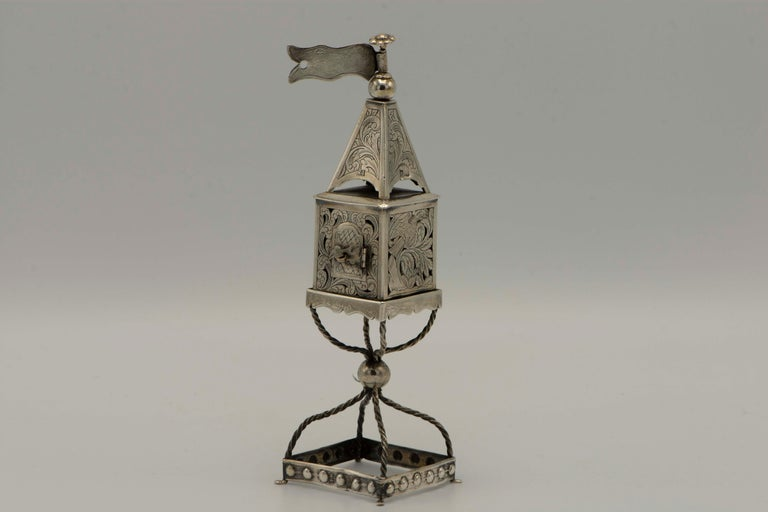 Handmade silver spice tower, Minsk, Russian Empire, 1878. Beautifully engraved with eagle, ox, and lion amongst foliage, the spice box has a hinged door shaped as a bird, resting on wirework stem. Marked on body door, dome, and foot.  Every item