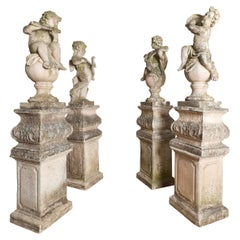 Late 19th Century Set of Four Baroque Style Cast Stone Putti
