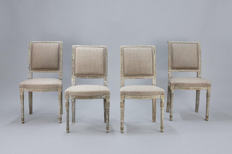 Set of four late 19th century Swedish chairs, wonderful carved details, dry scraped back to the original pale blue grey finish. Smartly reupholstered, Sweden, circa 1890. Priced as a set, seat height 46cm