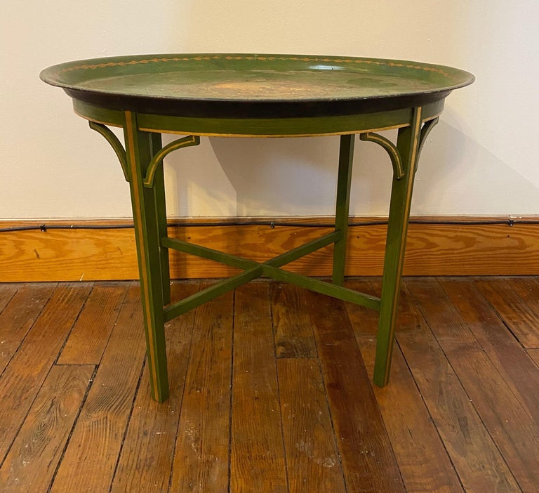 Late 19th century told tray mounted as side table on wooden base.