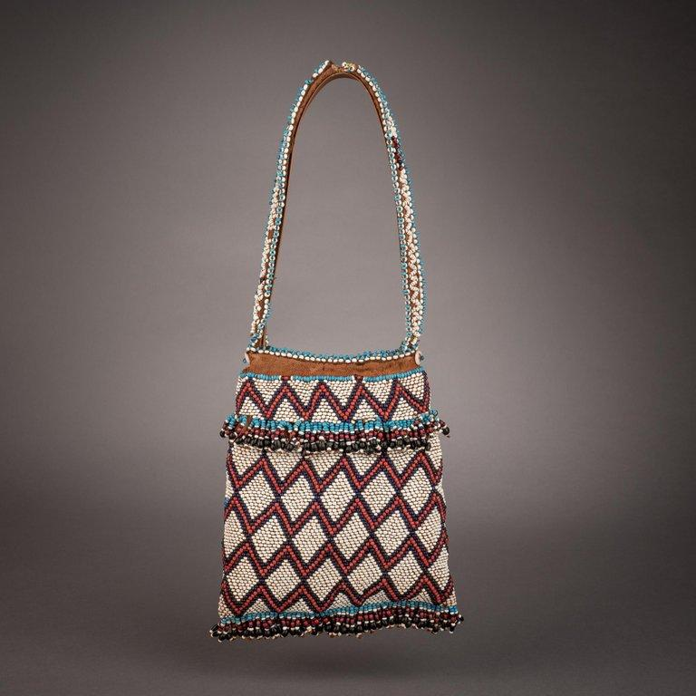 Means of carrying tobacco were as important in southern Africa as those of sampling it, and gaily beaded purses were widely produced for that purpose. Decorated as vividly as any other example of the region's beadwork, such bags would often be worn