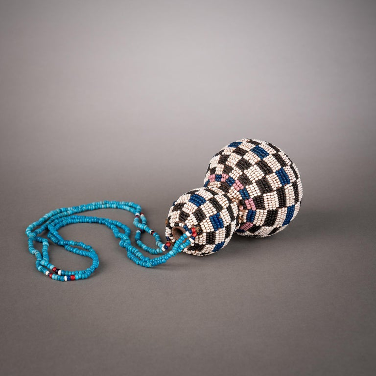 Gourds were a favored item among southern African tribes, carried by both men and women and decorated with a wide variety of methods, whether incised, inlaid with detailed wire patterns, or sheathed in elaborate beadwork. Calabashes, such as the