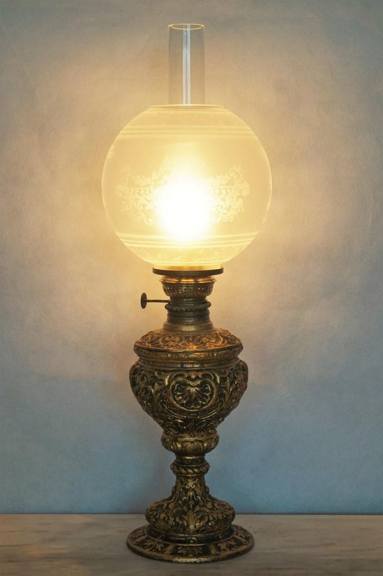 Victorian style heavy cast gilt bronze oil lamp converted to electric table lamp, etched glass globe and clear glass chimney, France, 1880-1890. This oil lamp has been converted to electric in the 1930s.