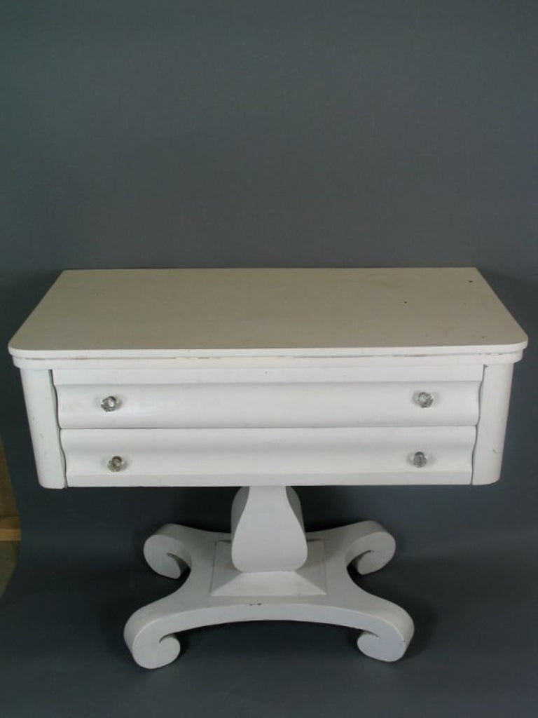 1-605 two-drawer console on pedestal base with crystal knobs painted white.
