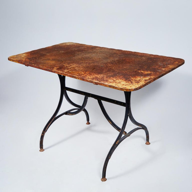 French Late 19th Century Yellow Garden Table with Natural Patina on Iron Trestle Base For Sale