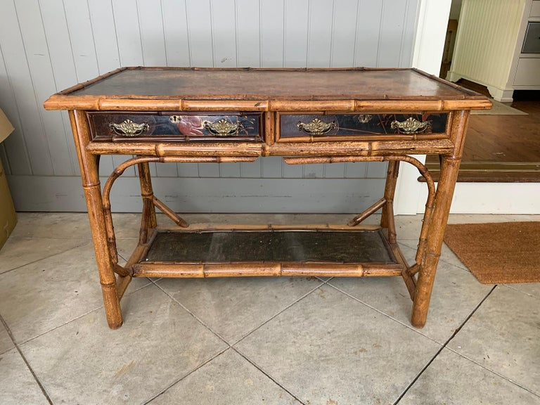 Late 19th-early 20th century bamboo desk with leather top Measures: 43