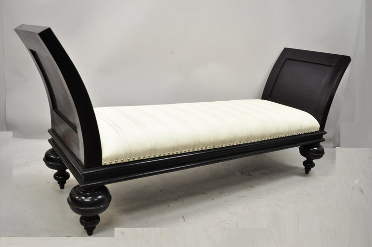 Late 20th century Hollywood Regency Italian style large black bun feet window bench. Item features burlap upholstered seat with green stripes, turn carved bun form feet, flared arms, black distressed finish, very nice item, great style and form,