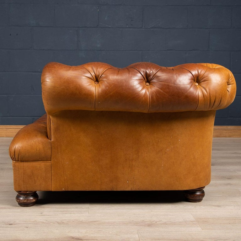 Superb late 20th century leather Chesterfield sofa. One of the most elegant models with button down seating, this fashionable item of furniture is capable of uplifting the interior space of any contemporary or traditional home, the Classic color
