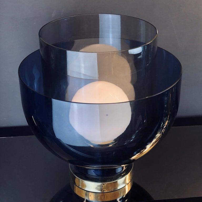 Brass base. White opaline glass to cover the E27 light bulb.