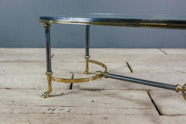 Superb quality Maison Charles goat hoof brass and steel coffee table, original glass surface. Repolished to its original high standard. As expected minor imperfections (scratches not chips) to both glass and steel.