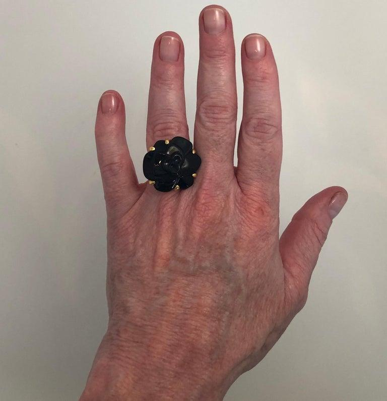 Stamped Chanel Black Onyx and 18-Karat Gold Camellia Cocktail Ring For Sale 6