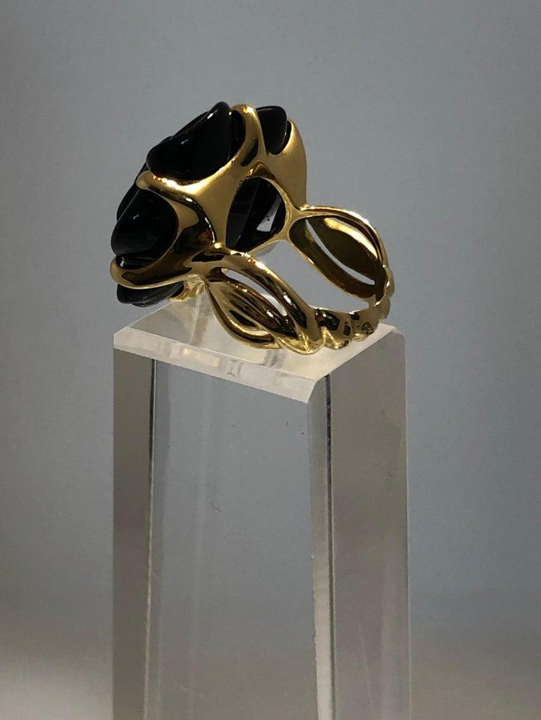 Offered is a signed and stamped 18-karat late 20th century (1999) Chanel black onyx and 18-karat yellow gold