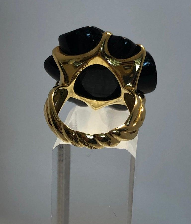 Modern Stamped Chanel Black Onyx and 18-Karat Gold Camellia Cocktail Ring For Sale