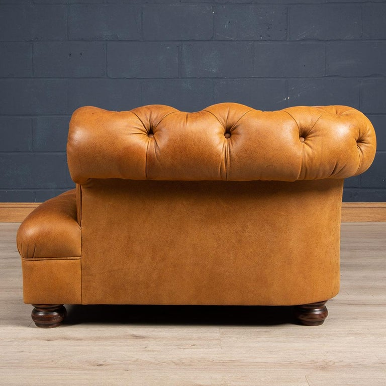 Superb late 20th century leather chesterfield sofa. One of the most elegant models with button down seating, this is a fashionable item of furniture capable of uplifting the interior space of any contemporary or traditional home, the classic color