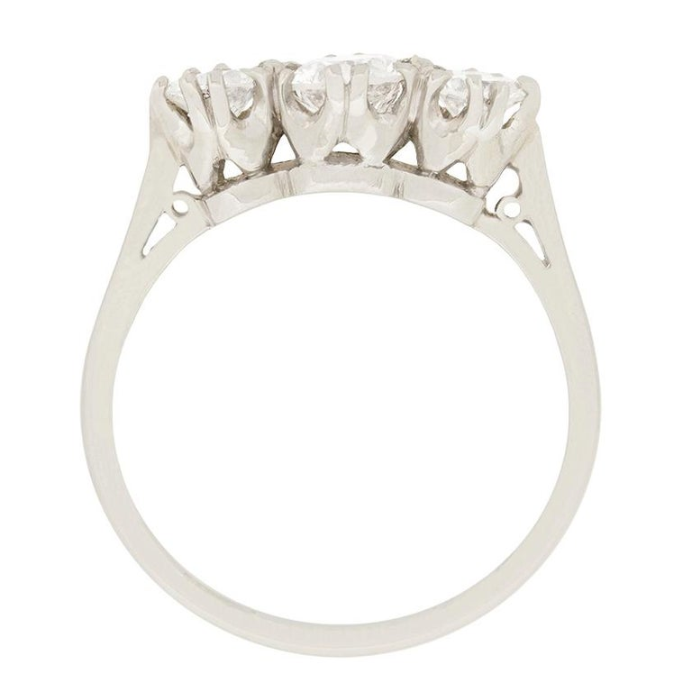 Three round brilliant diamonds sparkle in this vintage ring. The centre diamond is 0.50 carat, while the diamonds to either side are 0.25 carat, creating lovely balanced proportions. They are graded as I-J colour and VS clarity.  Set in platinum,