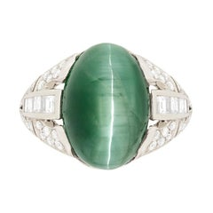 Late Art Deco 10.75 Carat Cat's Eye Tourmaline and Diamond Ring, circa 1940s