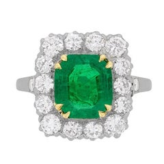 Late Art Deco Emerald and Diamond Cluster Ring, circa 1930s