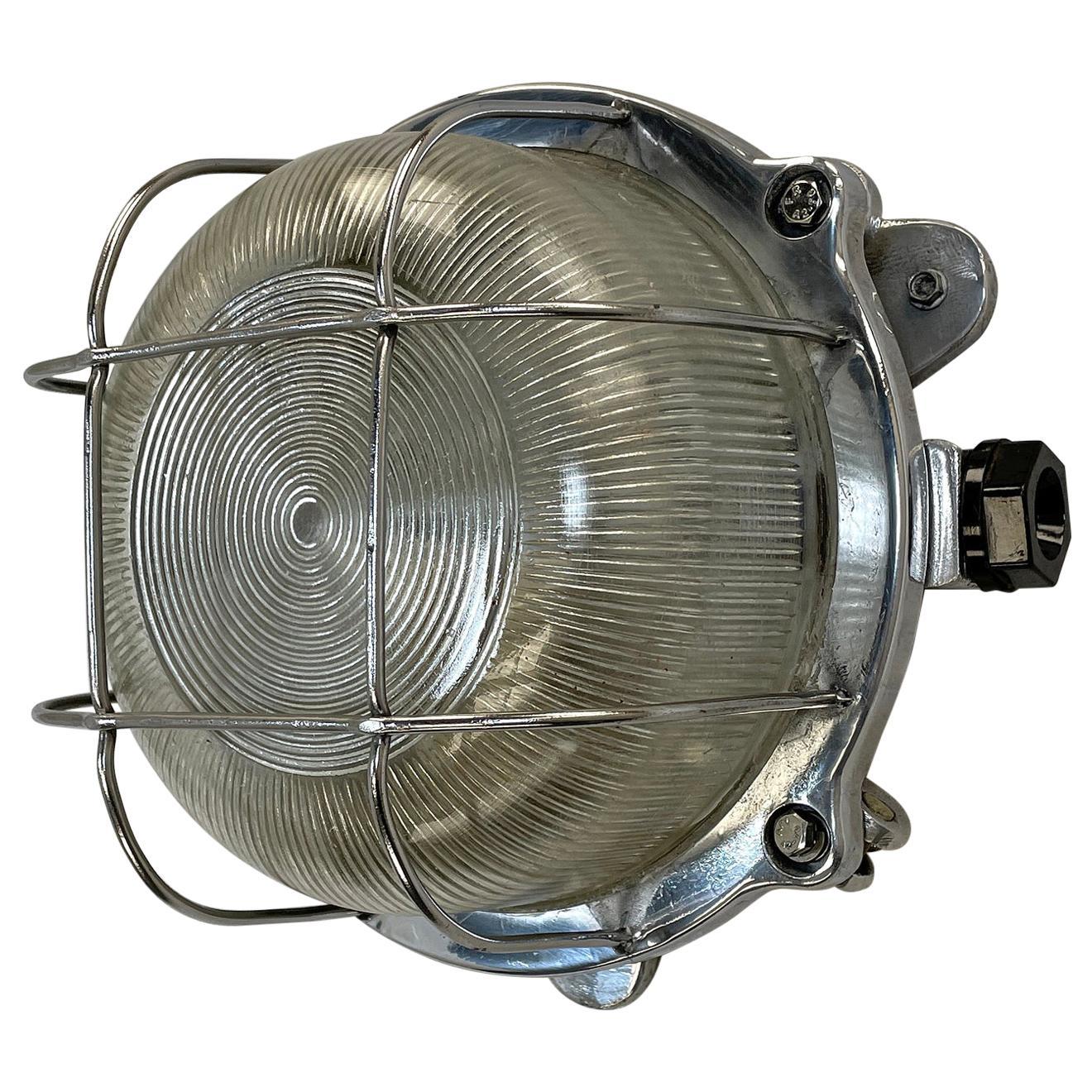 Late Century Industrial Cast Aluminium Circular Bulkhead lamp Reeded Glass Shade