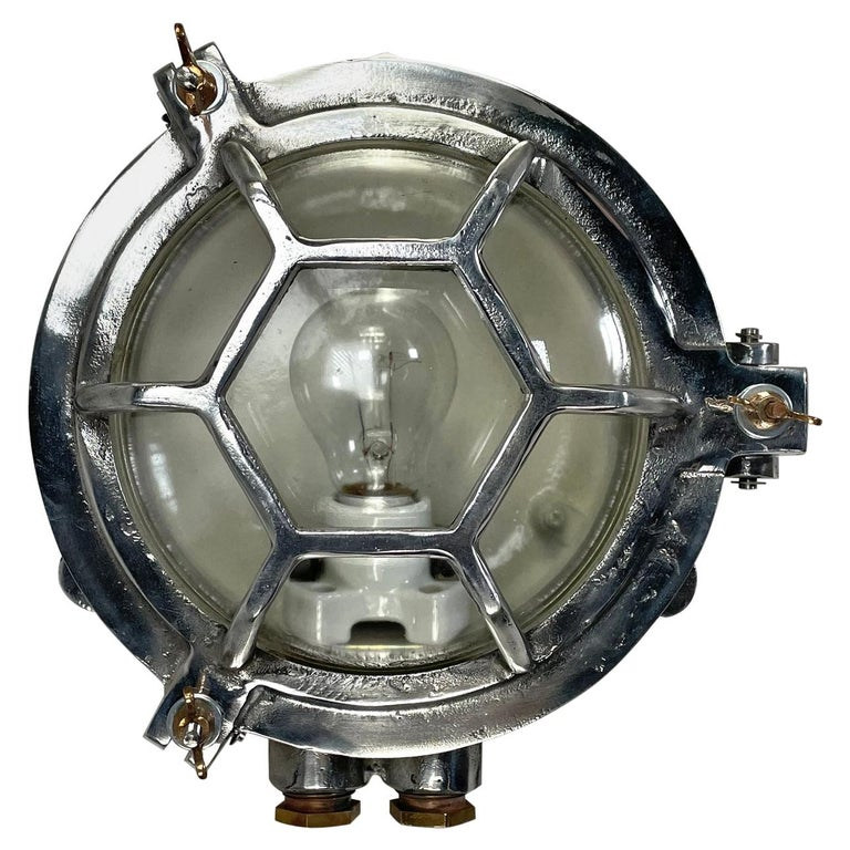 Late Century Japanese Industrial Cast Aluminium and Glass Circular Wall Light For Sale