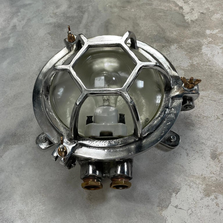 Late Century Japanese Industrial Cast Aluminium and Glass Circular Wall Light For Sale 4