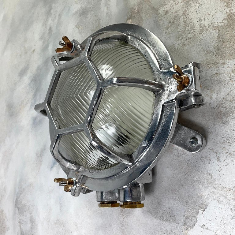 Late 20th Century Late Century Japanese Industrial Cast Aluminium & Reed Glass Circular Wall Light For Sale
