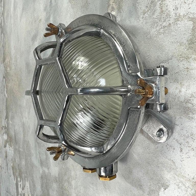 Aluminum Late Century Japanese Industrial Cast Aluminium & Reed Glass Circular Wall Light For Sale