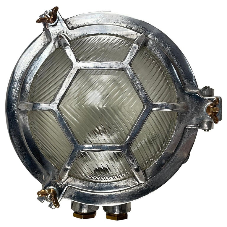 Late Century Japanese Industrial Cast Aluminium & Reed Glass Circular Wall Light For Sale