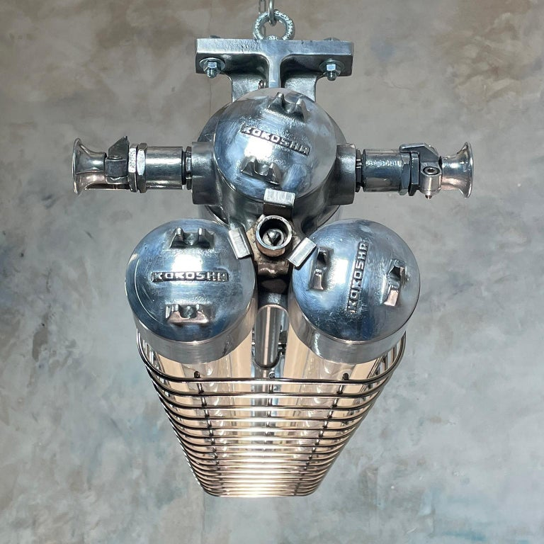 Late Century Japanese Industrial Cast Aluminum Strip Light with Chrome Cage For Sale 7