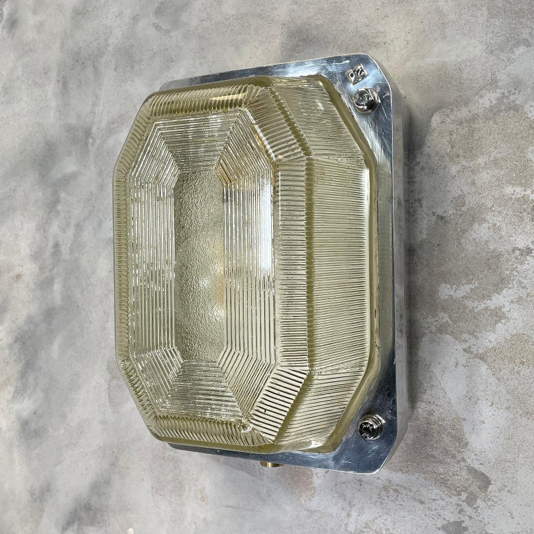 Are British made bulkhead lamp by Victor a manufacturer of lighting for use in hazardous locations such oil rigs, mines and large sea going vessels.  The main body of the lamp is reeded / prismatic glass which gives a soft diffusion output of