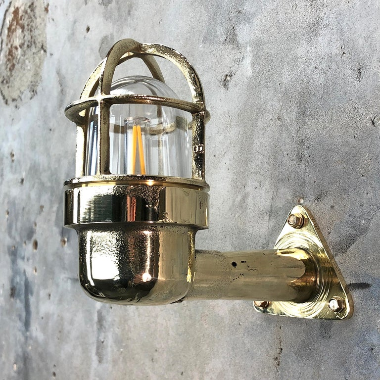 Pressed Late Century Small Industrial Brass Wall Light, Glass Dome, Cage, Edison Bulb For Sale