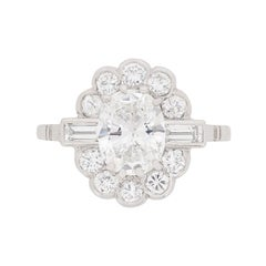 Late Deco 1.29 Carat Oval Diamond Cluster Ring, circa 1930s