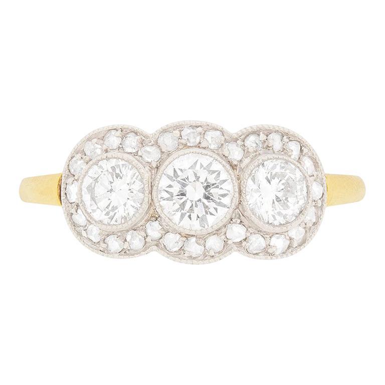 Late Deco Diamond Three-Stone with Diamond Halo Ring, circa 1940s