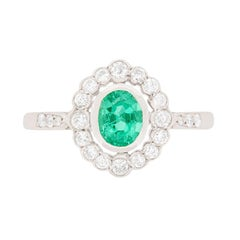 Late Deco Emerald and Diamond Cluster Ring, circa 1940s