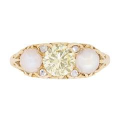 Late Deco Fancy Yellow Diamond and Pearl Three-Stone Ring, circa 1940s