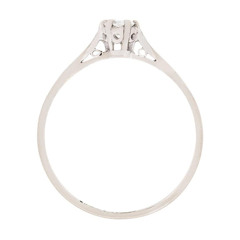 Dating to the 1930s, this timeless and classic solitaire has a 0.20 carat, transitional cut diamond, as the main attraction. It has been beautifully claw set within a handmade collet, made in platinum. The diamond is G in colour and VS in clarity.
