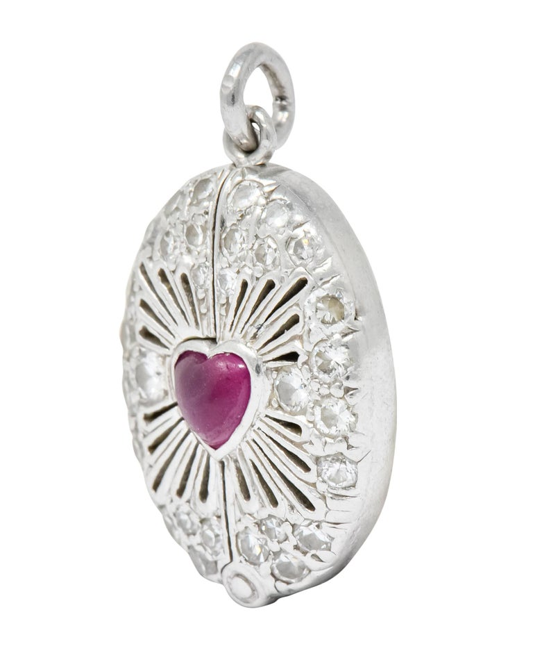 Late Edwardian Ruby Diamond Platinum Sacred Heart Cross Articulated Charm In Excellent Condition For Sale In Philadelphia, PA