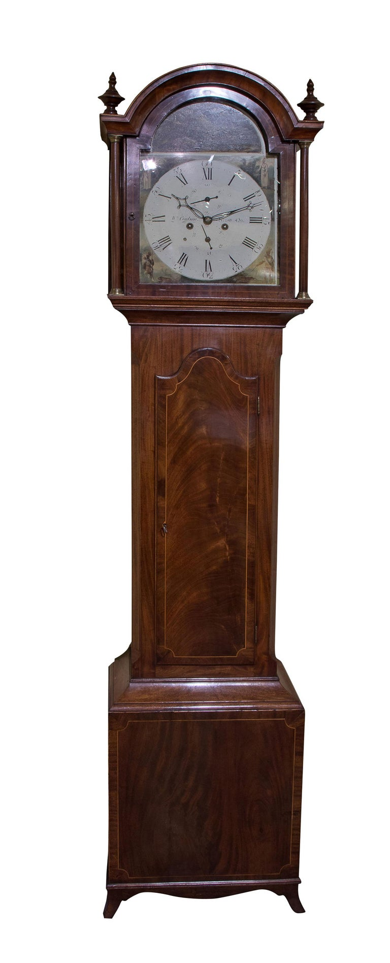 Late Georgian mahogany longcase clock, the painted dial signed WM Coulson of North Shields, with spandrels emblematic of the four continents below an arch painted with wild boar. A finely figured case, crossbanded and string inlay with 8 day